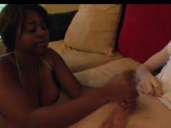 Ebony babe tugging his...
